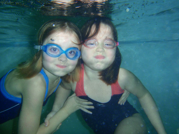 two swimmers under water